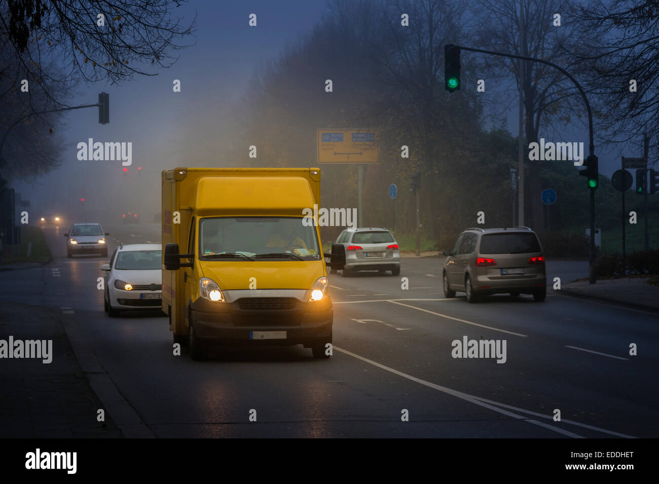 Germany, Grevenbroich, road traffic on dull November morning - Stock Image