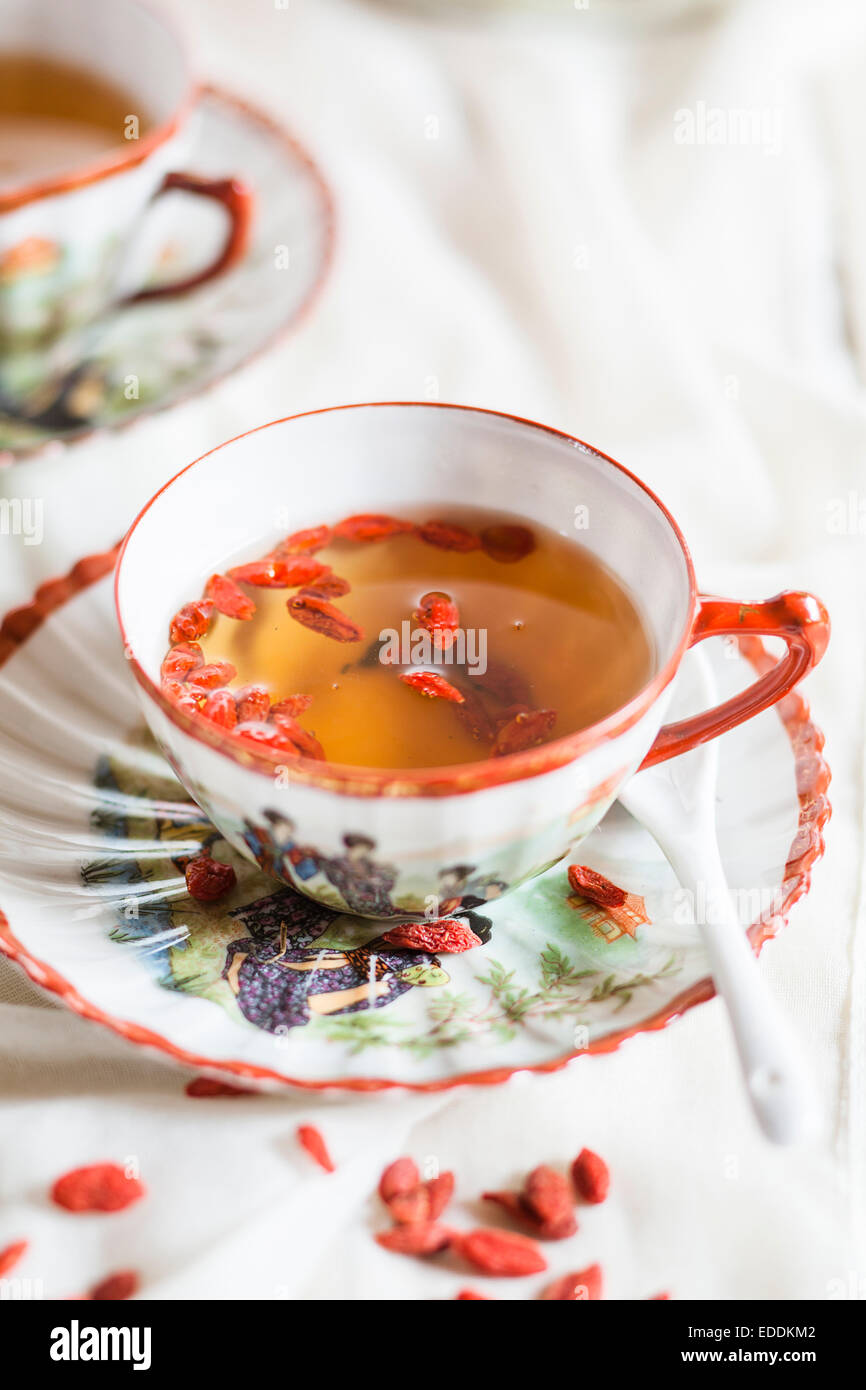 Cup Of Green Tea With Dried Goji Berries Lycium Barbarum Stock