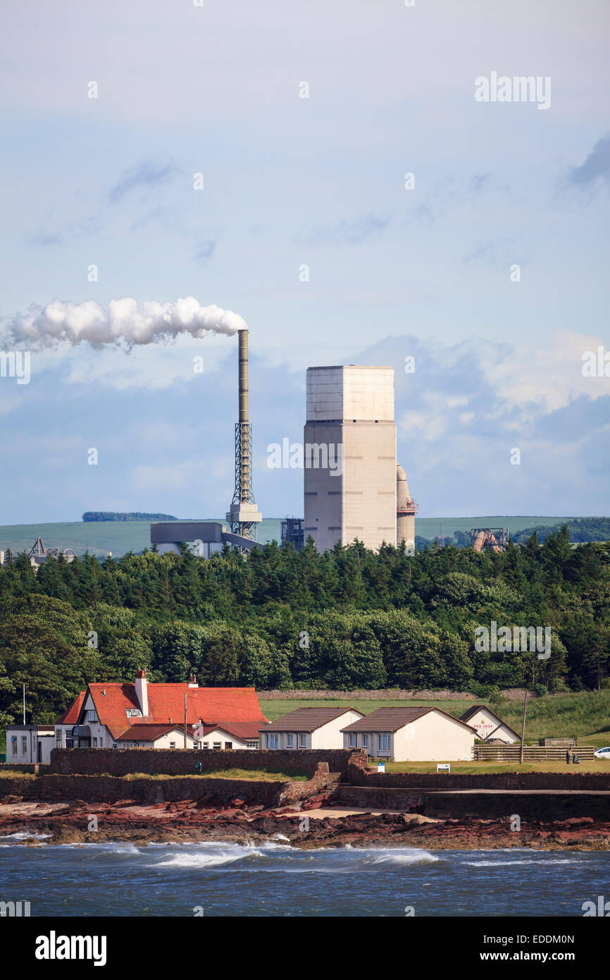 Smoke coming out from factory chimney. East Lothian. Scotland. UK. - Stock Image