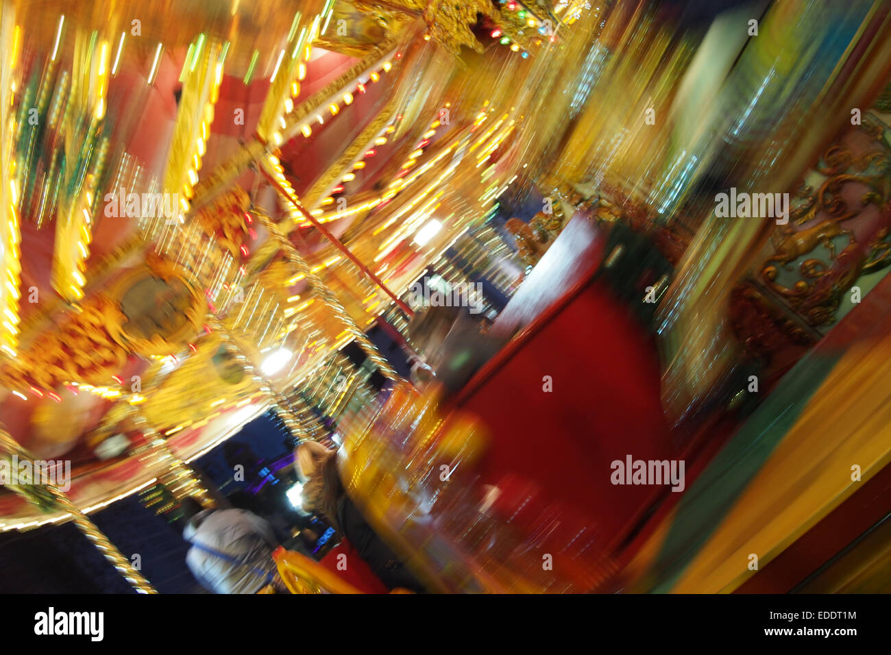 Carousel at the Christmas Funfair at Leicester Square in London - Stock Image