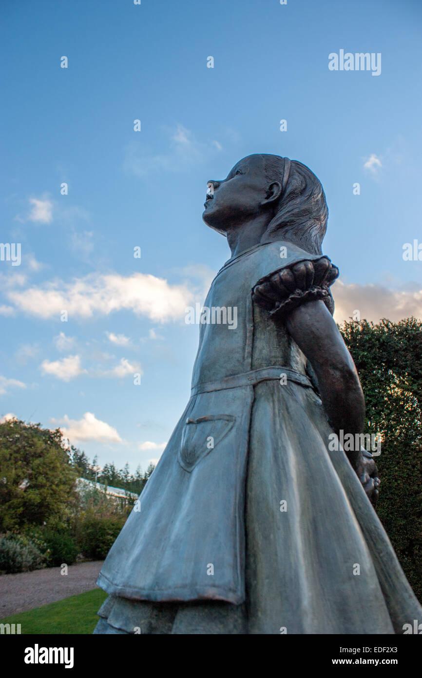 Alice in wonderland statue stock photos alice in - Alice in wonderland garden statues ...