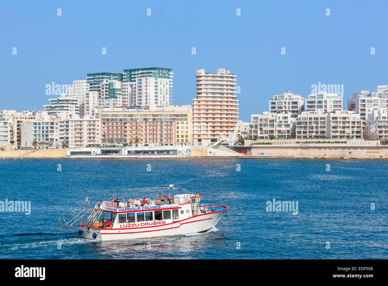 Tigne Point Sliema Skyline Marsamxett Harbour and Tourist boat Valletta Malta EU Europe - Stock Image