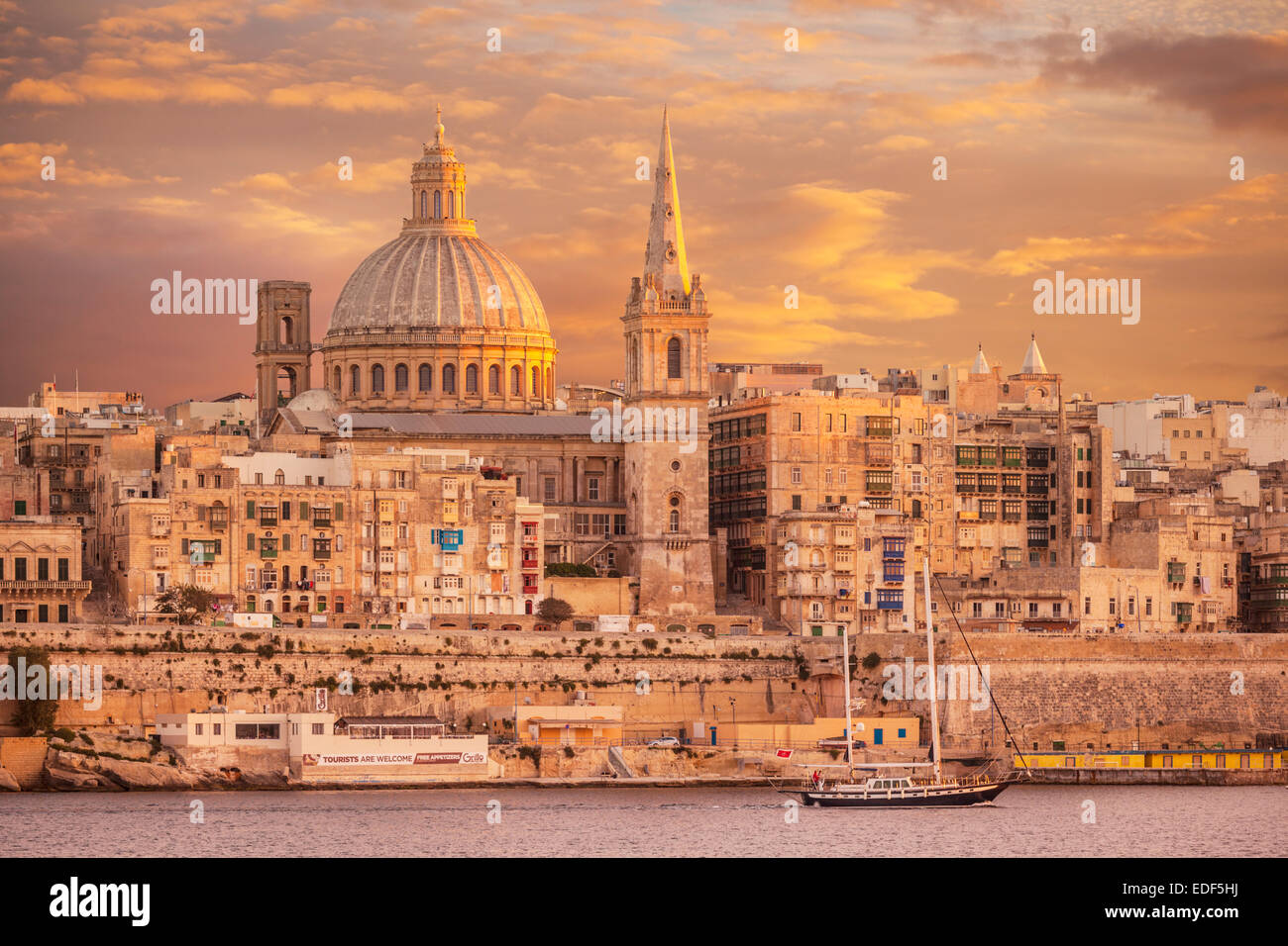 Valletta Skyline at Sunset with the Dome of the Carmelite Church and St Pauls Anglican Cathedral Valletta Malta - Stock Image