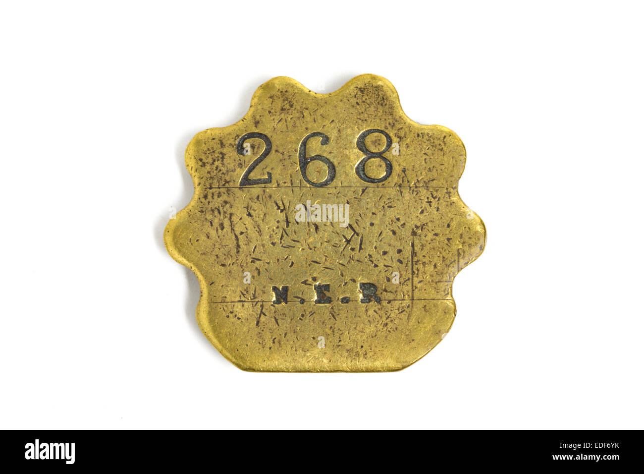 Brass pay token, or tally, issued by North Eastern Railway (NER) before grouping in 1923. - Stock Image