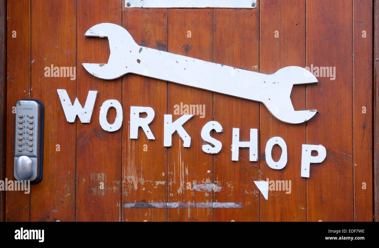 Door of workshop with spanner motif, England UK - Stock Image