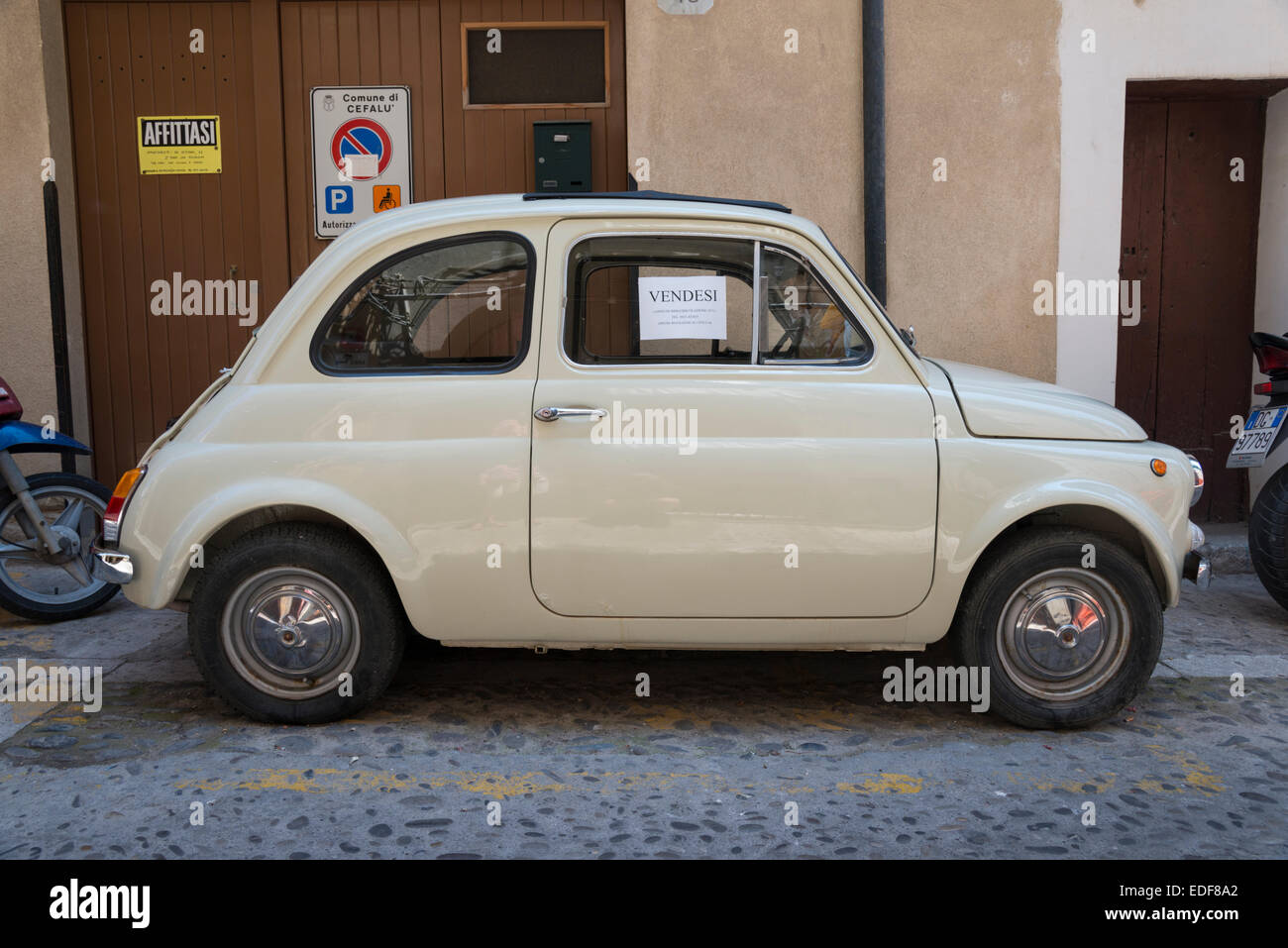 An old Fiat 500 cinquecento car for sale on a street in Cefalu ...