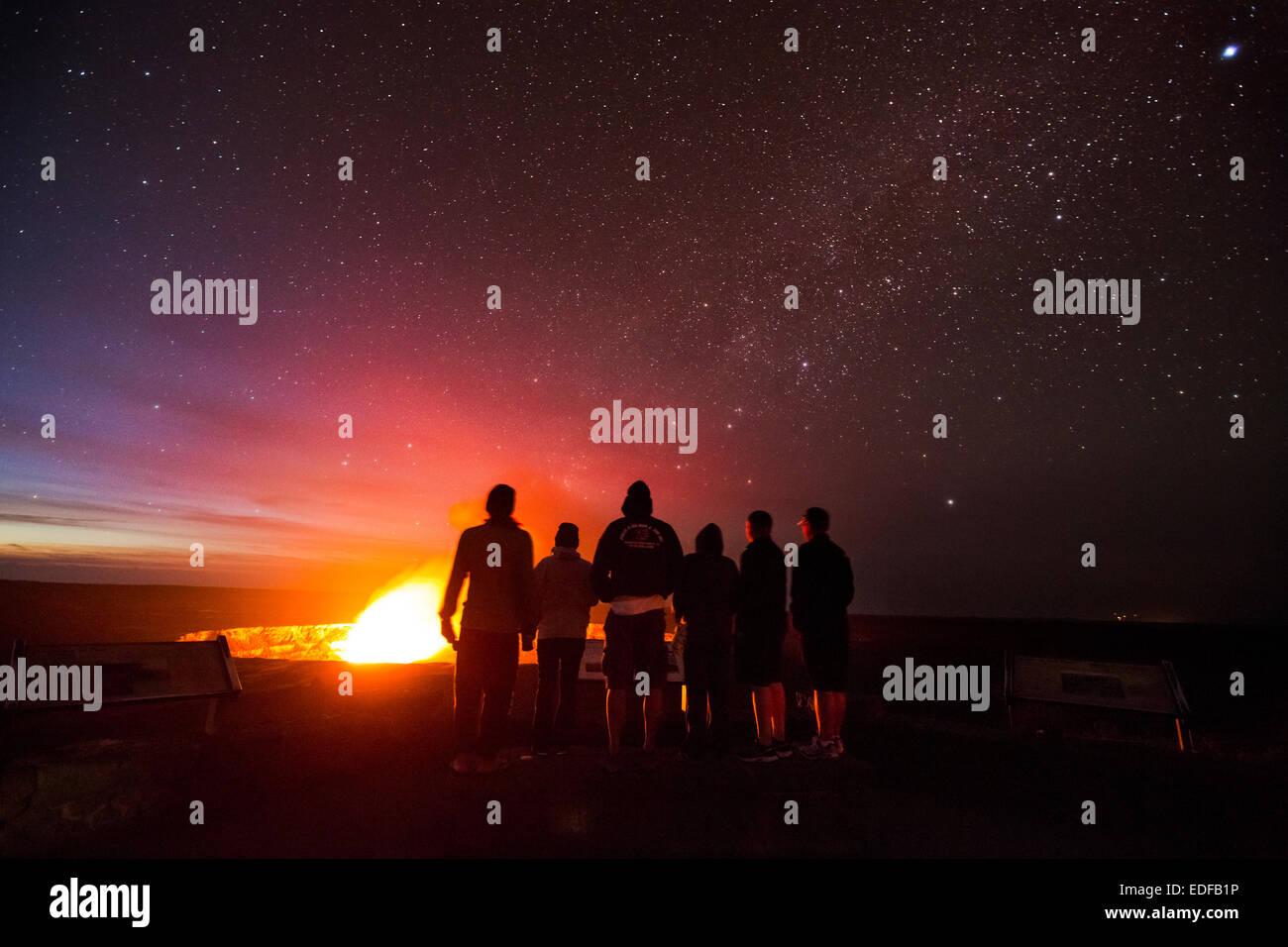Tourists looking at Halemaumau Crater, Kilauea Volcano, Hawai`i - Stock Image