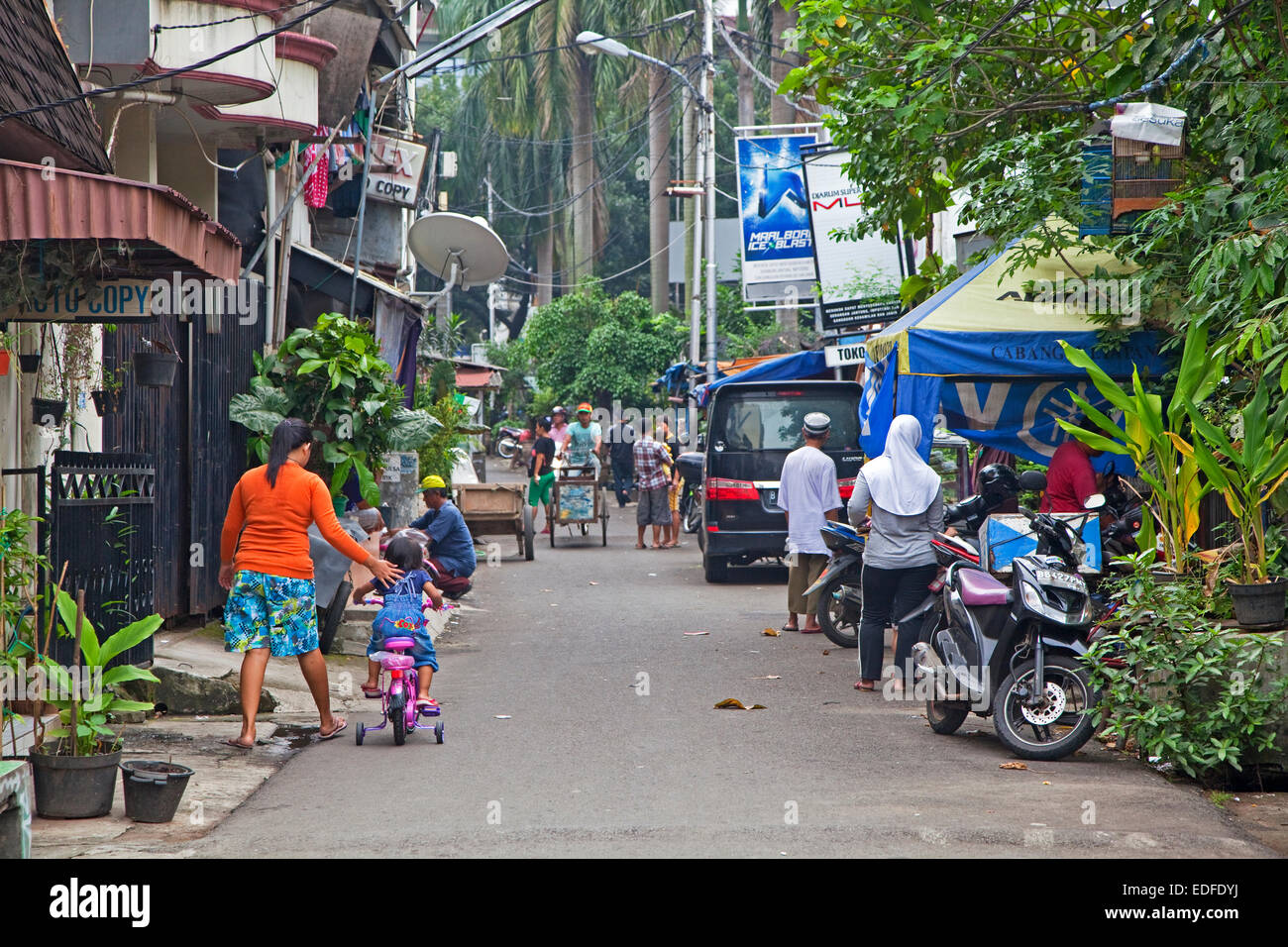 Daily life in street in the capital city Jakarta, Java, Indonesia - Stock Image