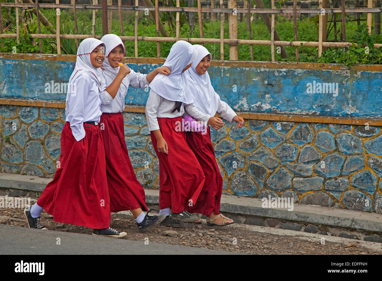 Happy Indonesian school children wearing red and white Hijab uniforms, Kota Bandung, West Java, Indonesia - Stock Image