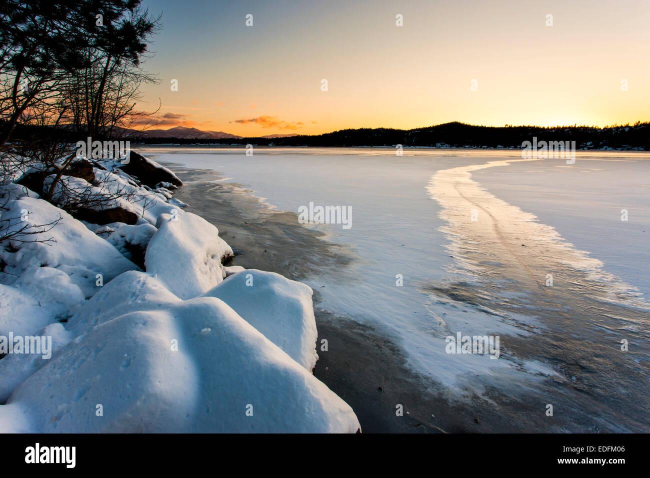 Frozen Lake at sunset. - Stock Image