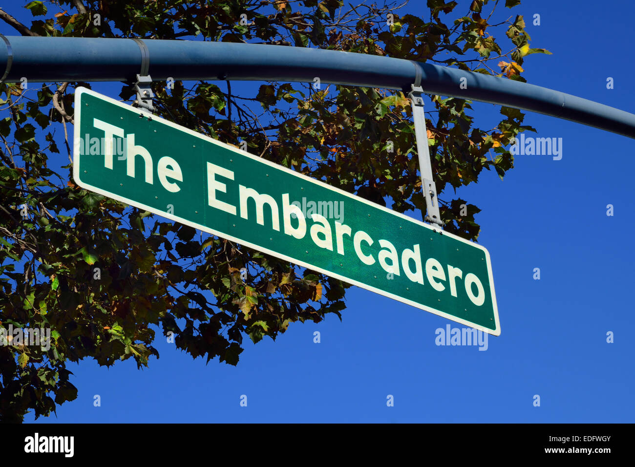 Sunlit road sign for the Embarcadero a waterfront road and walkway servicing the Port of San Francisco USA - Stock Image