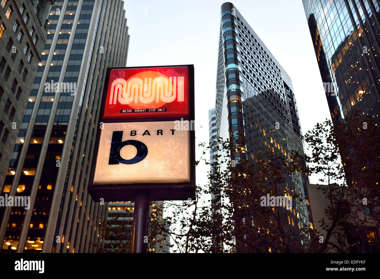 Lit sign at dusk for entrance to 'Bart' (Bay Area Rapid Transit ) on Market St. San Francisco California - Stock Image
