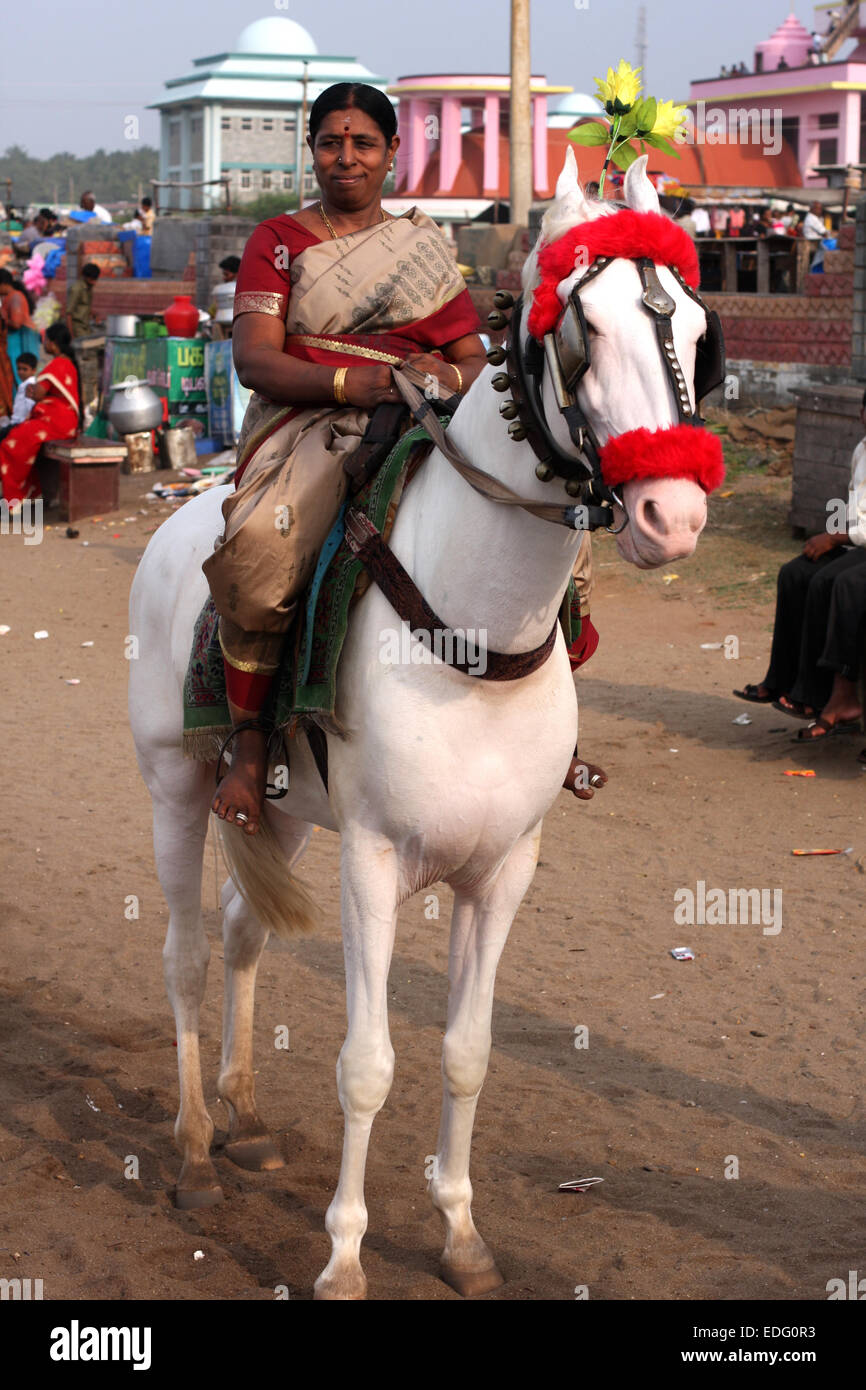 Hindu lady going for a pony ride on the beach at Kanyakumari, Tamil Nadu, India - Stock Image
