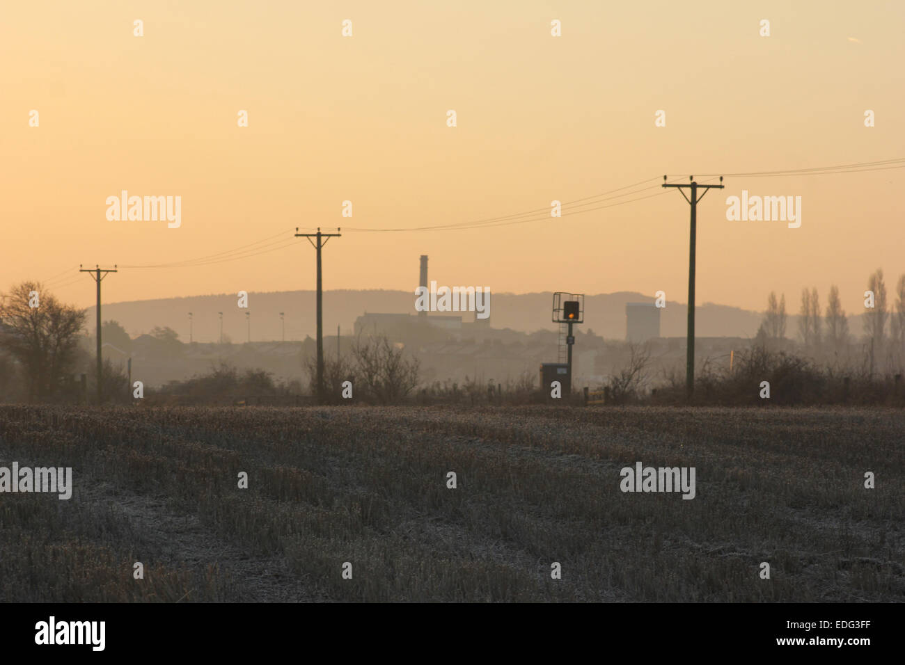 A March morning in 2013 and the early morning sun dawns over the village of Burscough in West Lancashire. - Stock Image