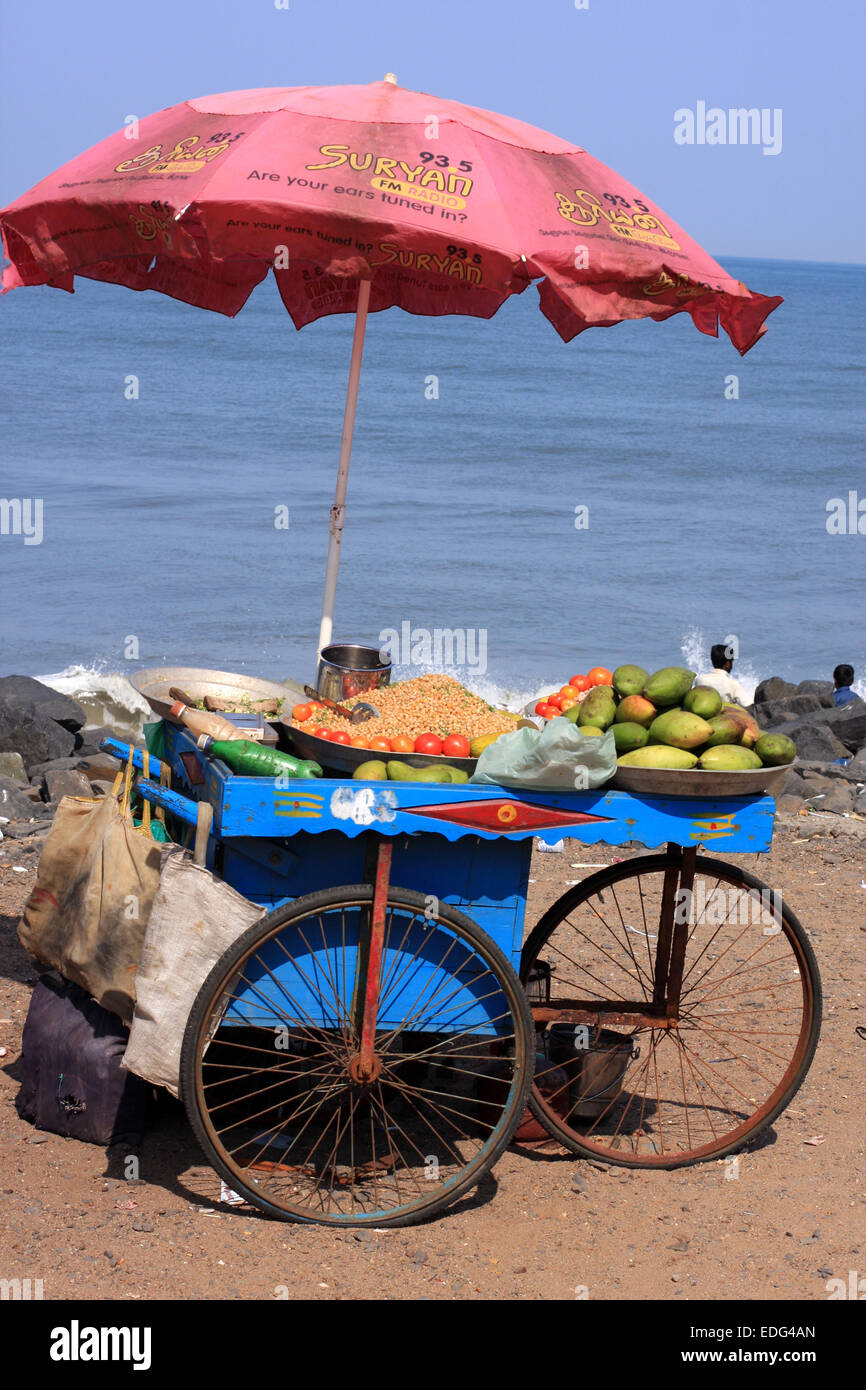 Cart offering mangoes and chaat on the beach at Pondicherry on a hot day in Tamil Nadu, India - Stock Image