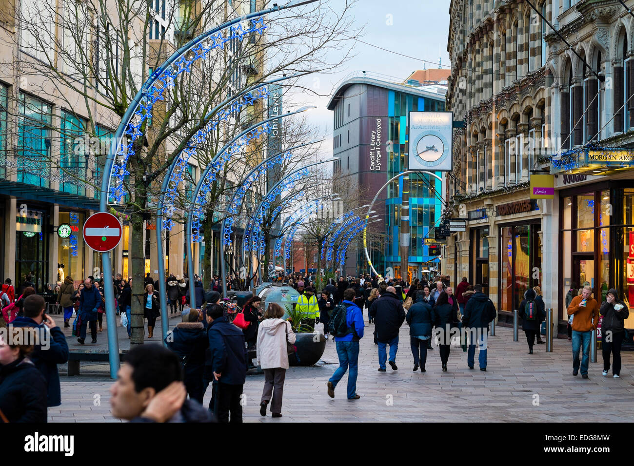 Crowds of people shopping on a winter afternoon in the pedestrianised area of  Cardiff city centre , the Capital - Stock Image