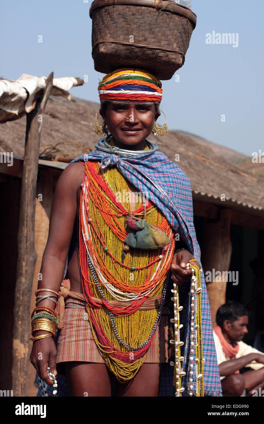 Tribal woman selling jewellery at Onkadelli Thursday market, Orissa, India - Stock Image