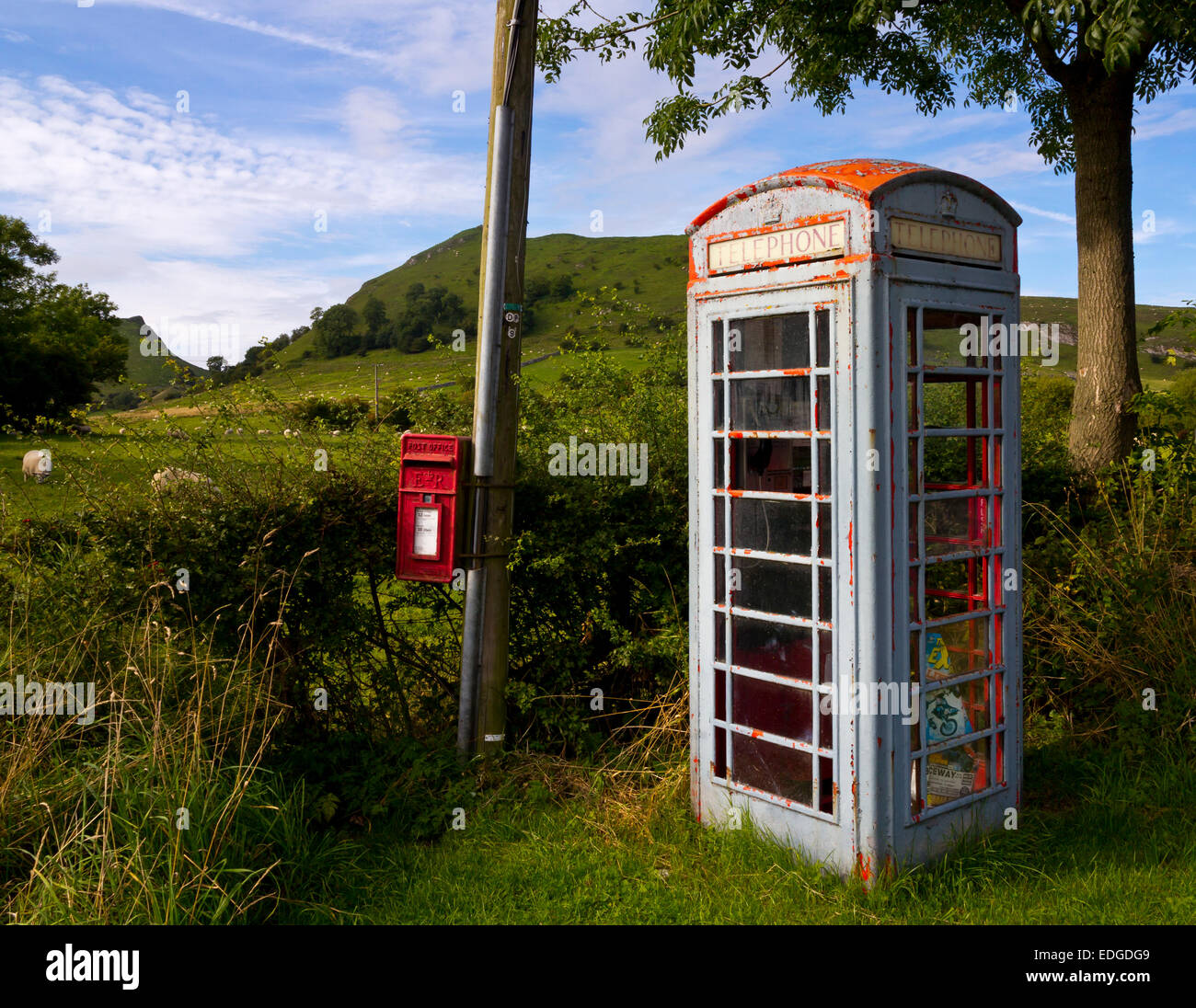 Old telephone kiosk and red letter box on telegraph pole at Glutton