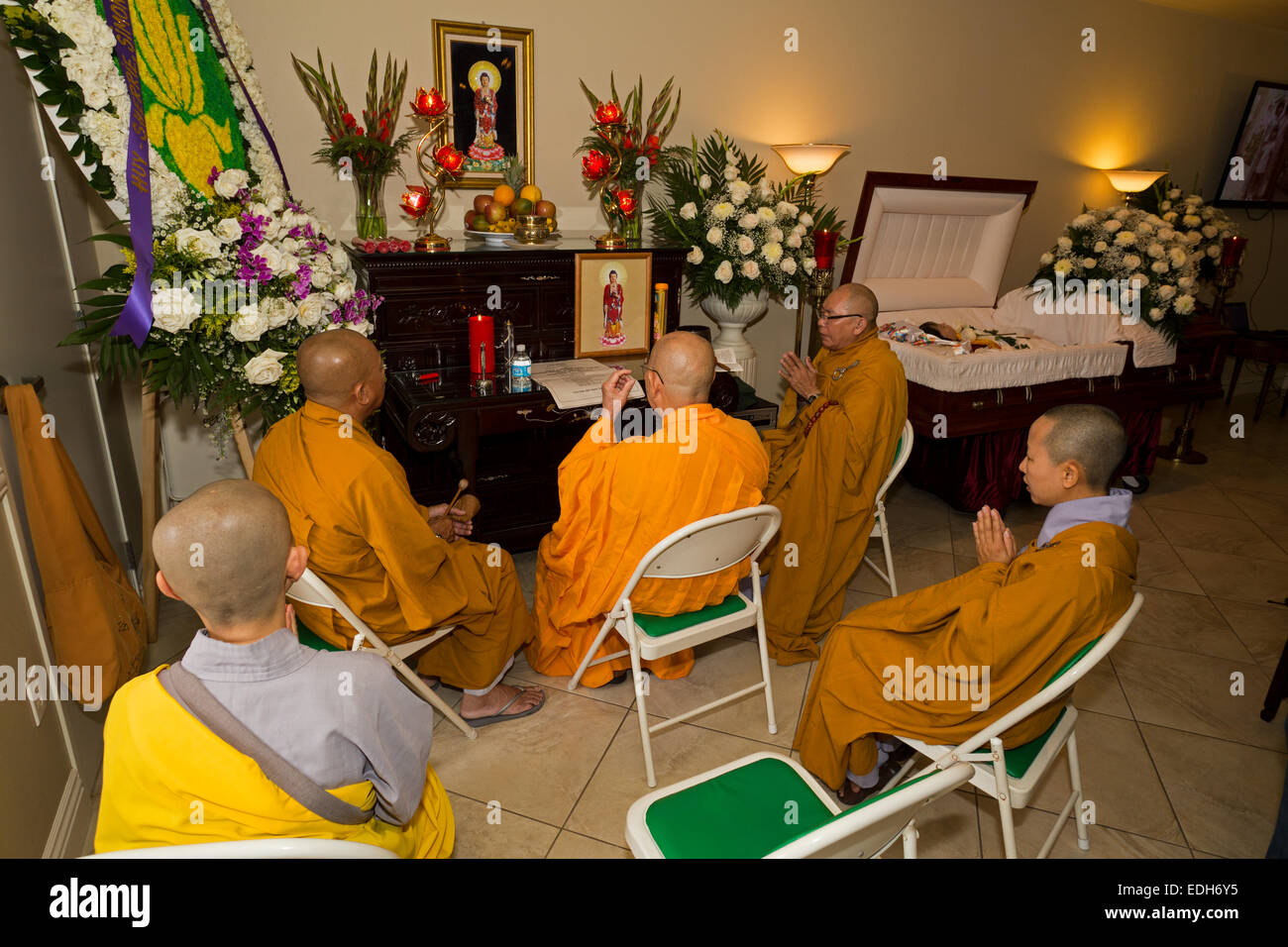 Buddhist monks, mourners, praying, Vietnamese funeral, memorial service, Little Saigon, city of Westminster, California Stock Photo