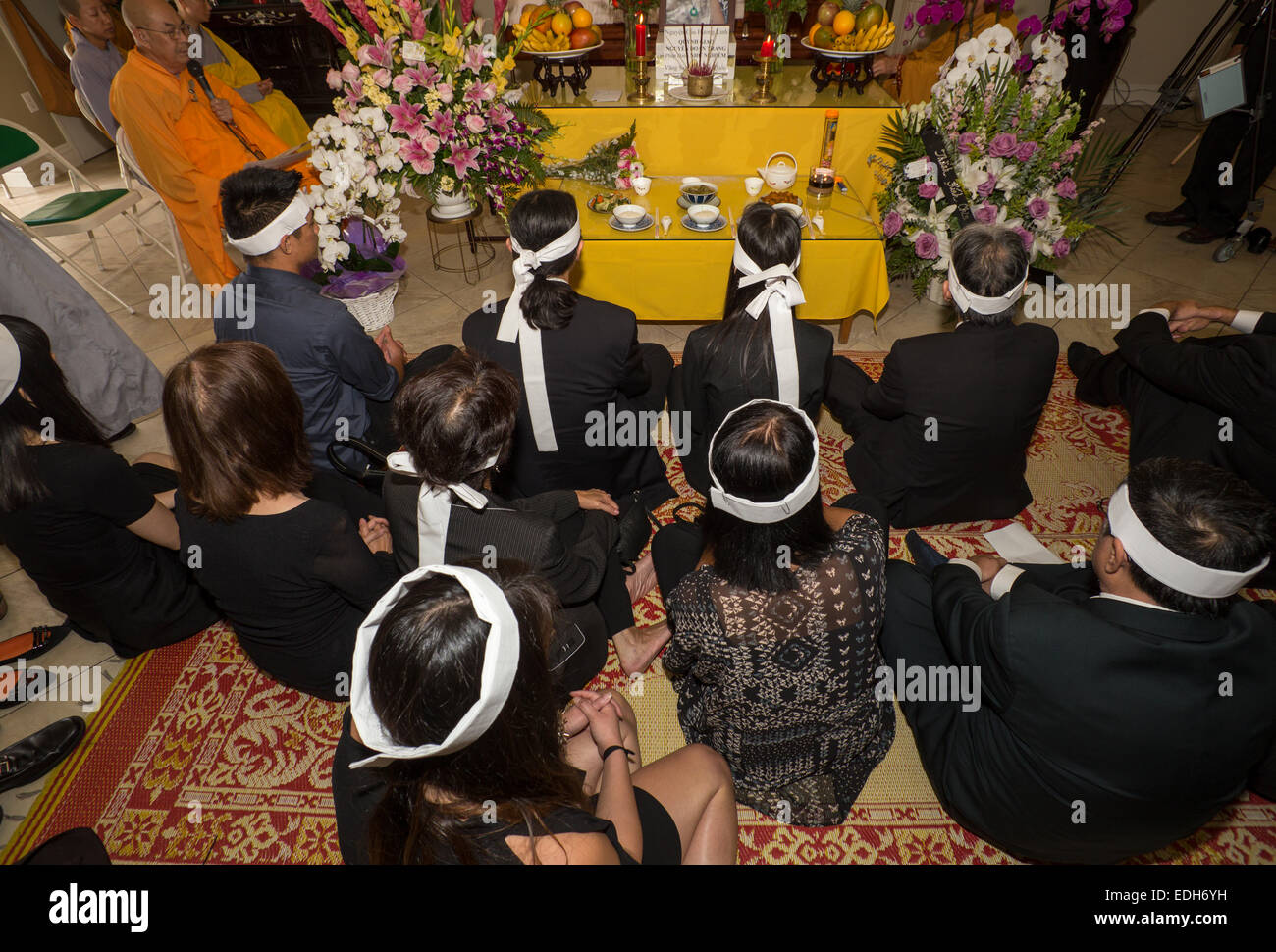 Family members, mourners at Vietnamese funeral service, Little Saigon district, city of Westminster, Orange County, Stock Photo