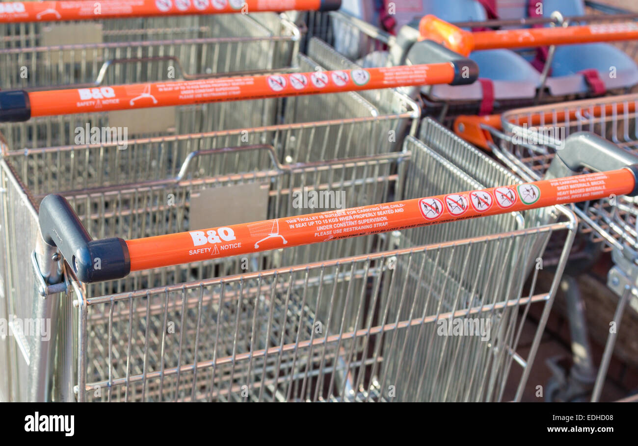 B&Q Shopping trolley with health and safety instructions. - Stock Image