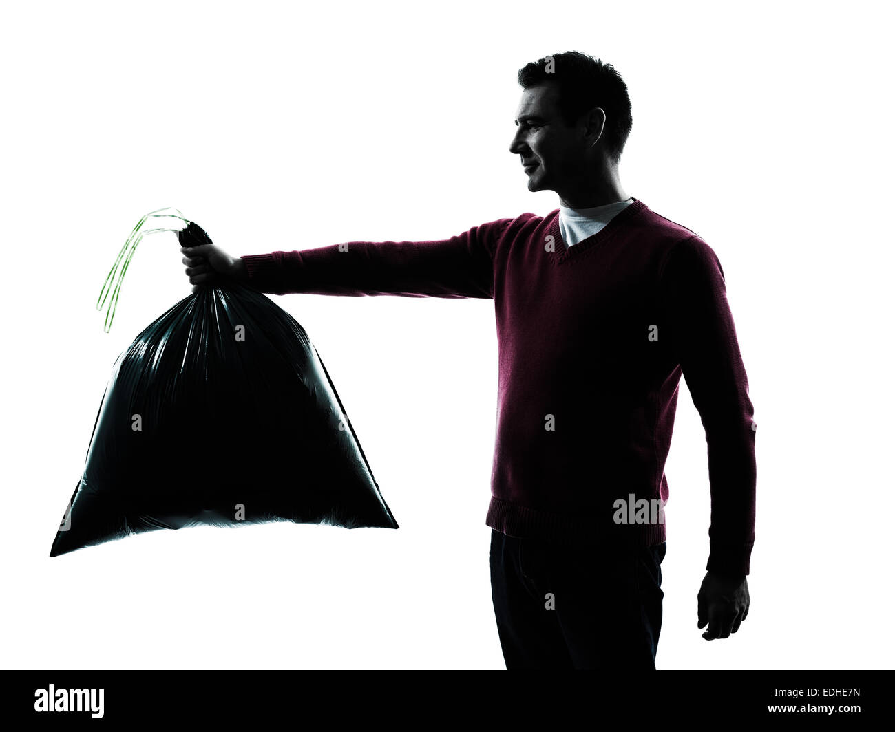 man dumping garbage bag in silhouettes on white background - Stock Image