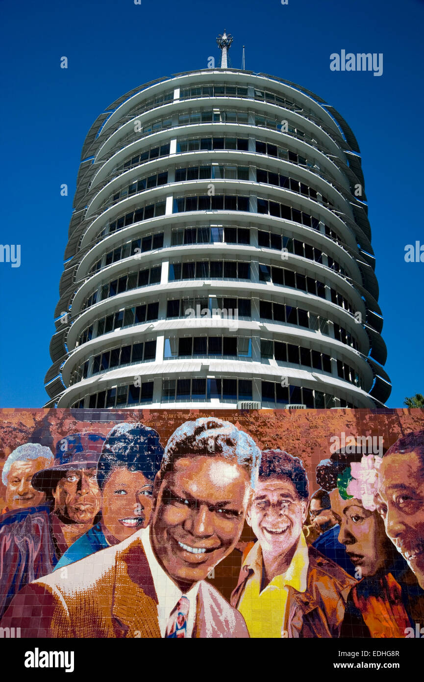 Capitol Record building and mural of great recording artists in Hollywood, California - Stock Image