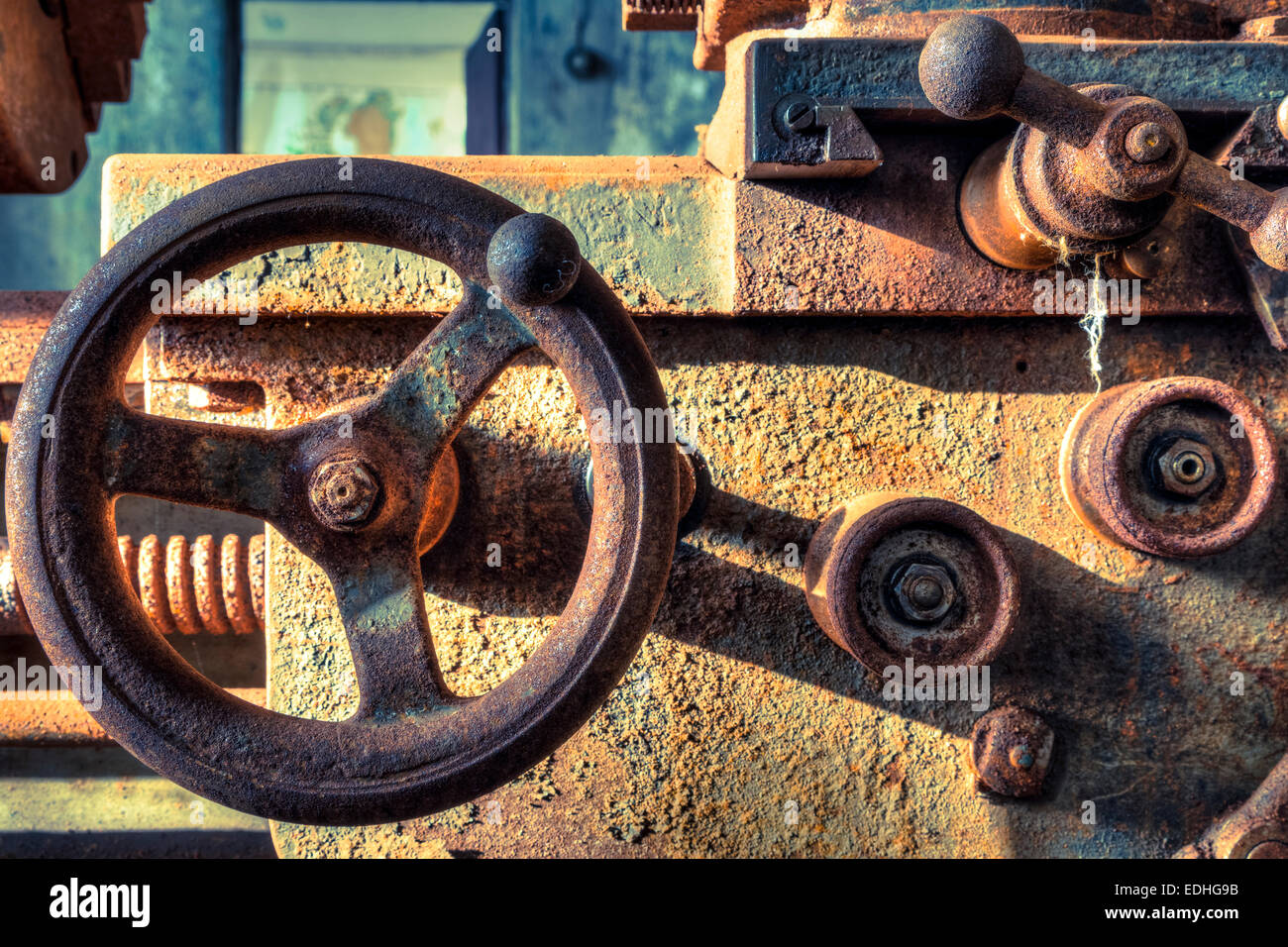 Closeup of rusted lathe knobs at an abandoned ship works in Iceland - Stock Image