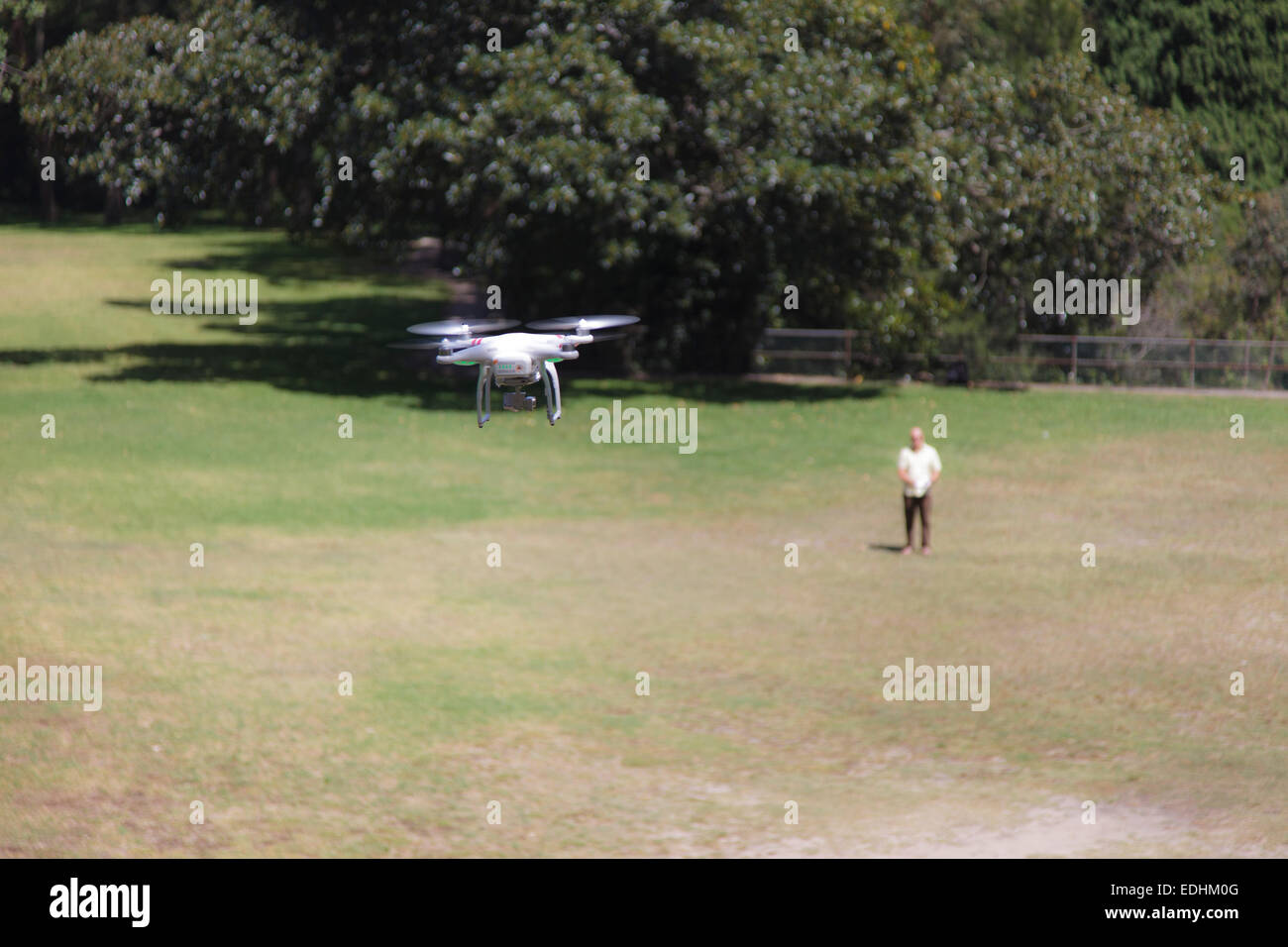 Drone Operator flying his drone - Stock Image
