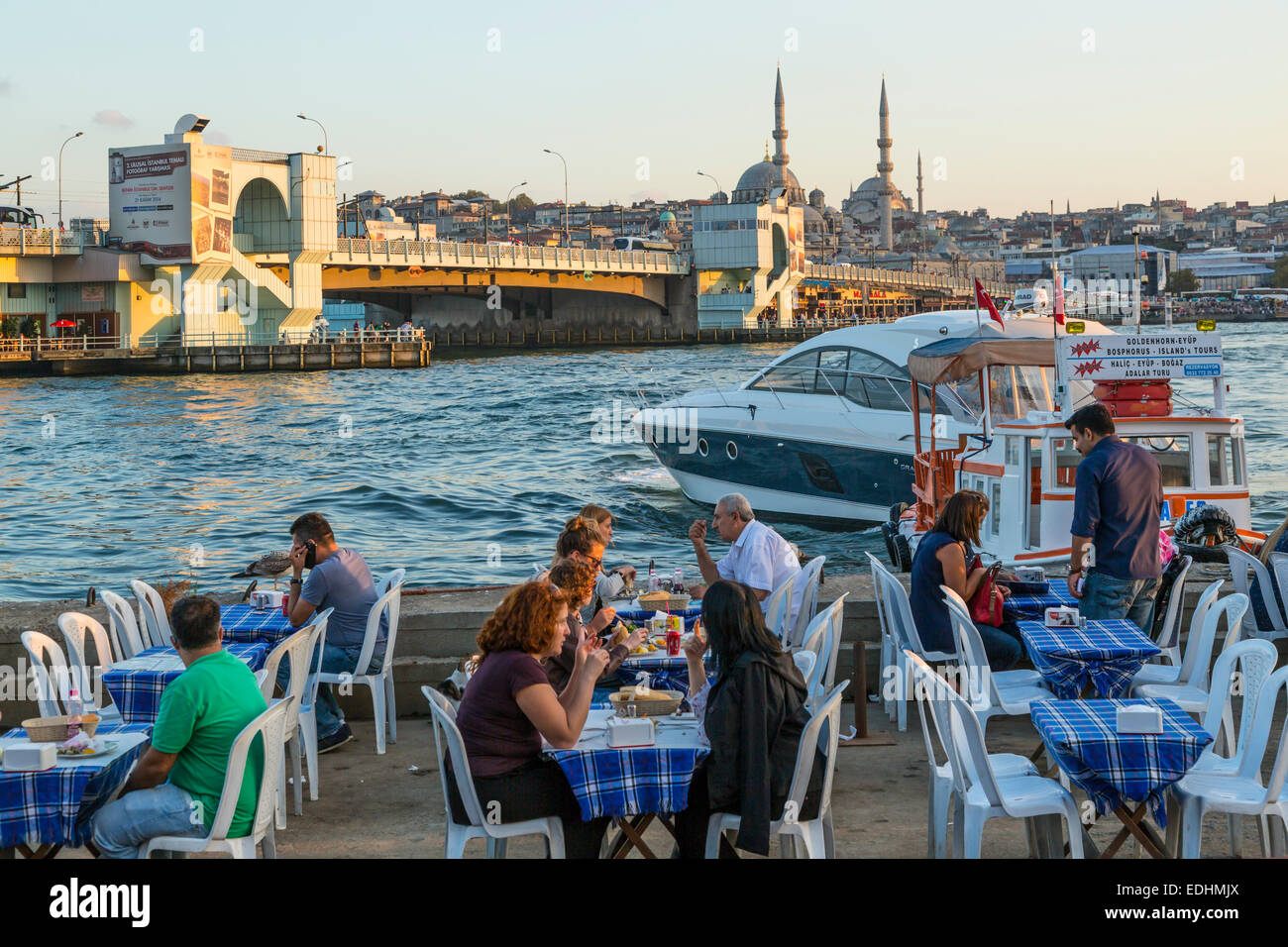 A small seafood restaurant overlooking the Golden Horn in Istanbul, Turkey, Eurasia. - Stock Image