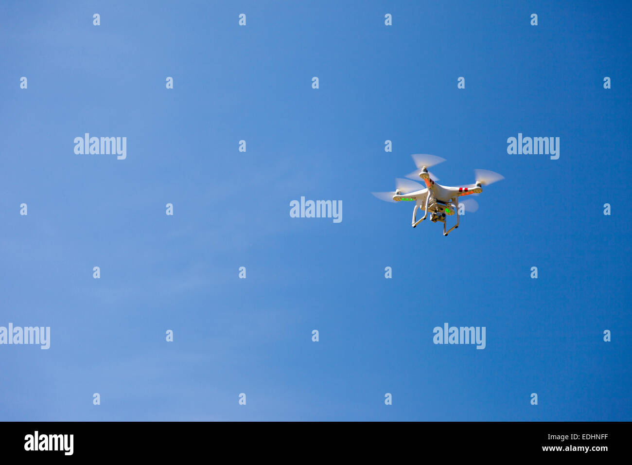 Lone Drone in a clear blue sky - Stock Image
