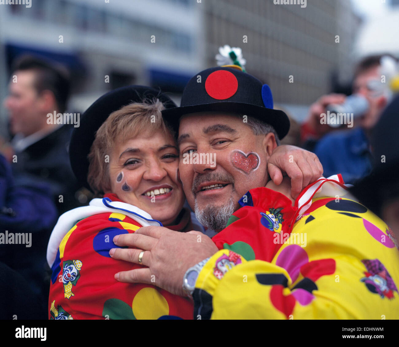 Rhenish carnival, street carnival, couple, woman 40 to 50 years, man 50 to 60 years, costuming, face painting, hats, - Stock Image