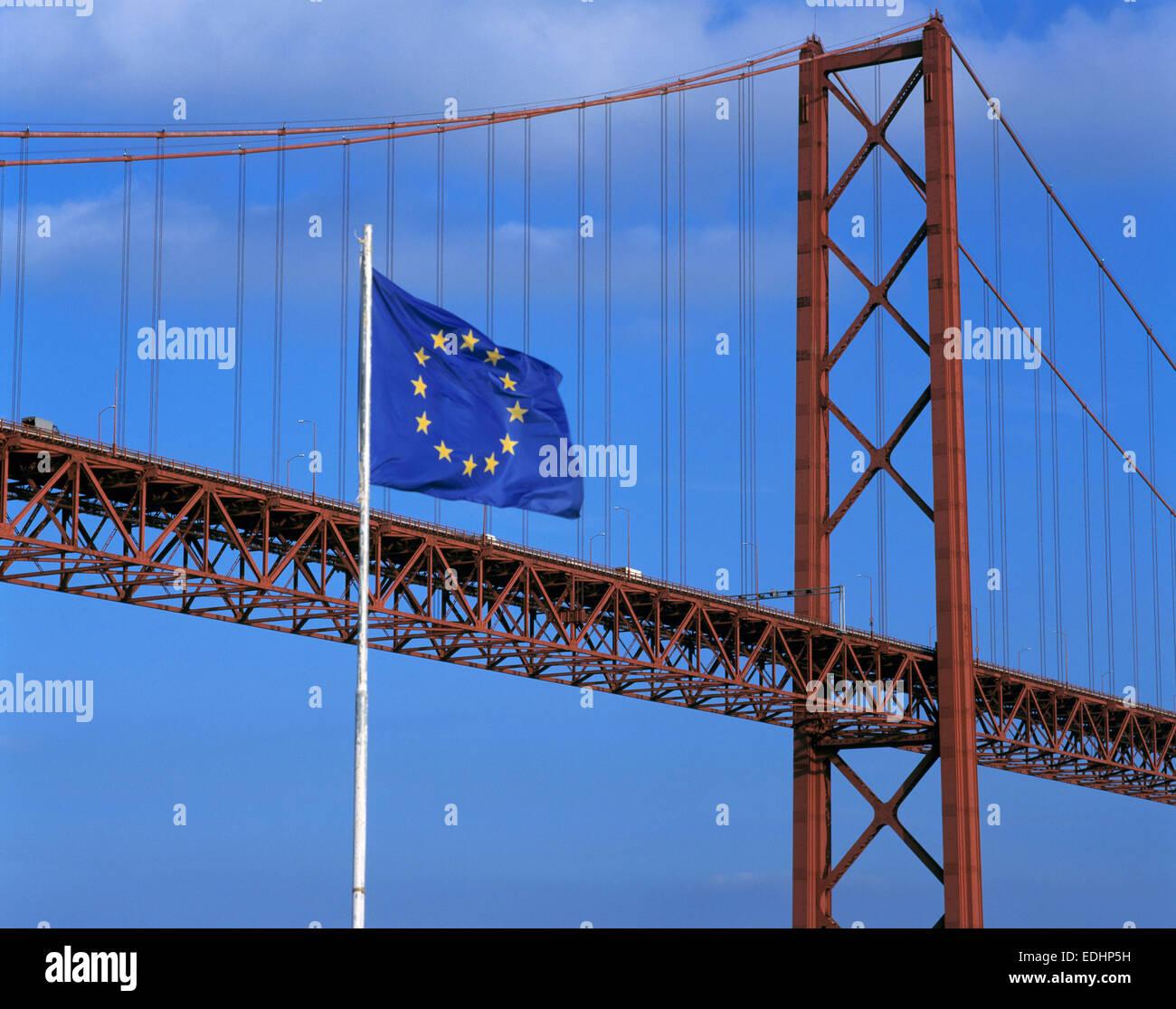 Portugal, P-Lisbon, Ponte 25 de Abril, suspension bridge across the Tejo river, railroad bridge, river bridge, flag Stock Photo
