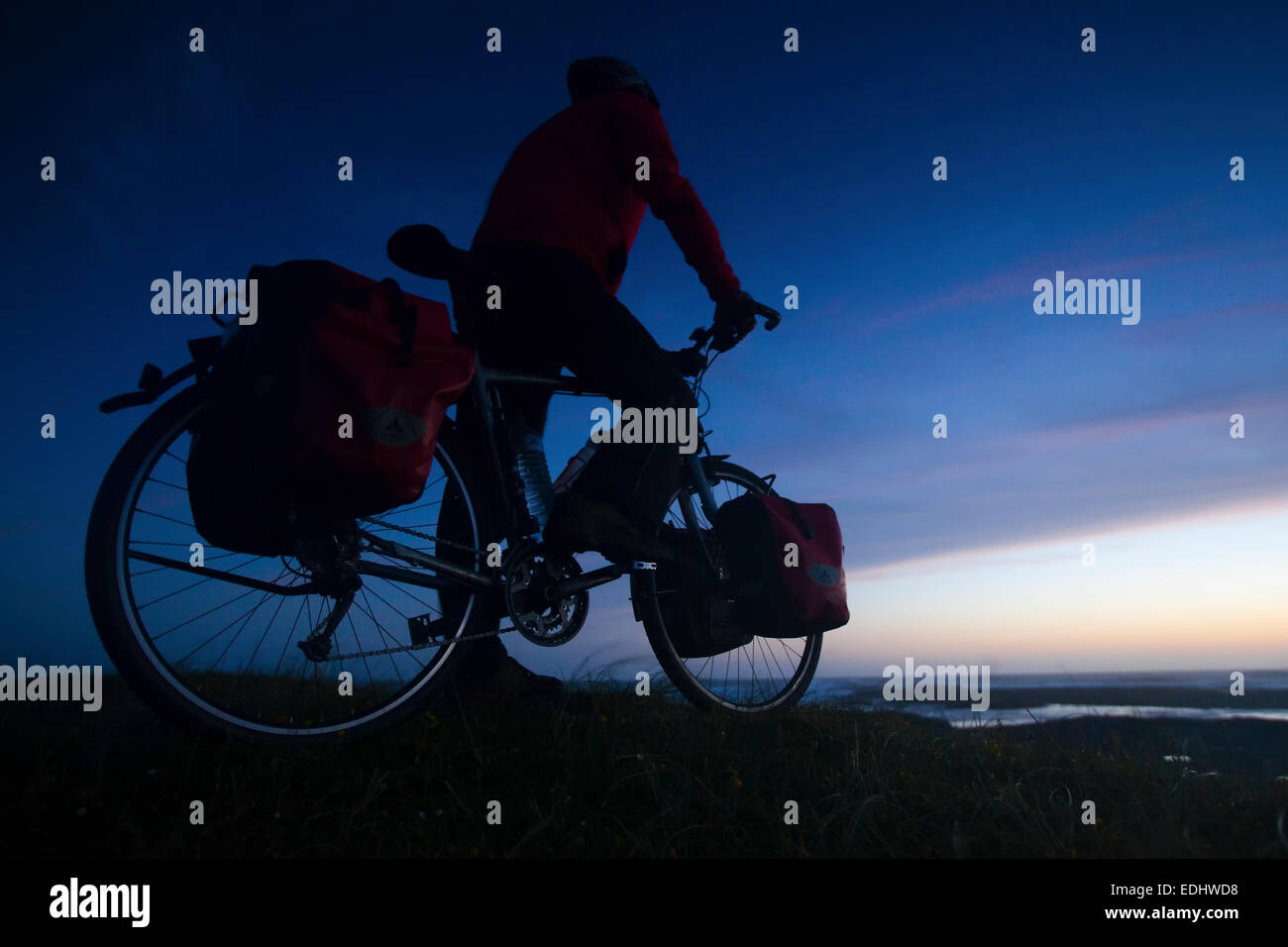Cyclist on a bicycle tour, Isle of Barra, Outer Hebrides, Scotland, United Kingdom - Stock Image