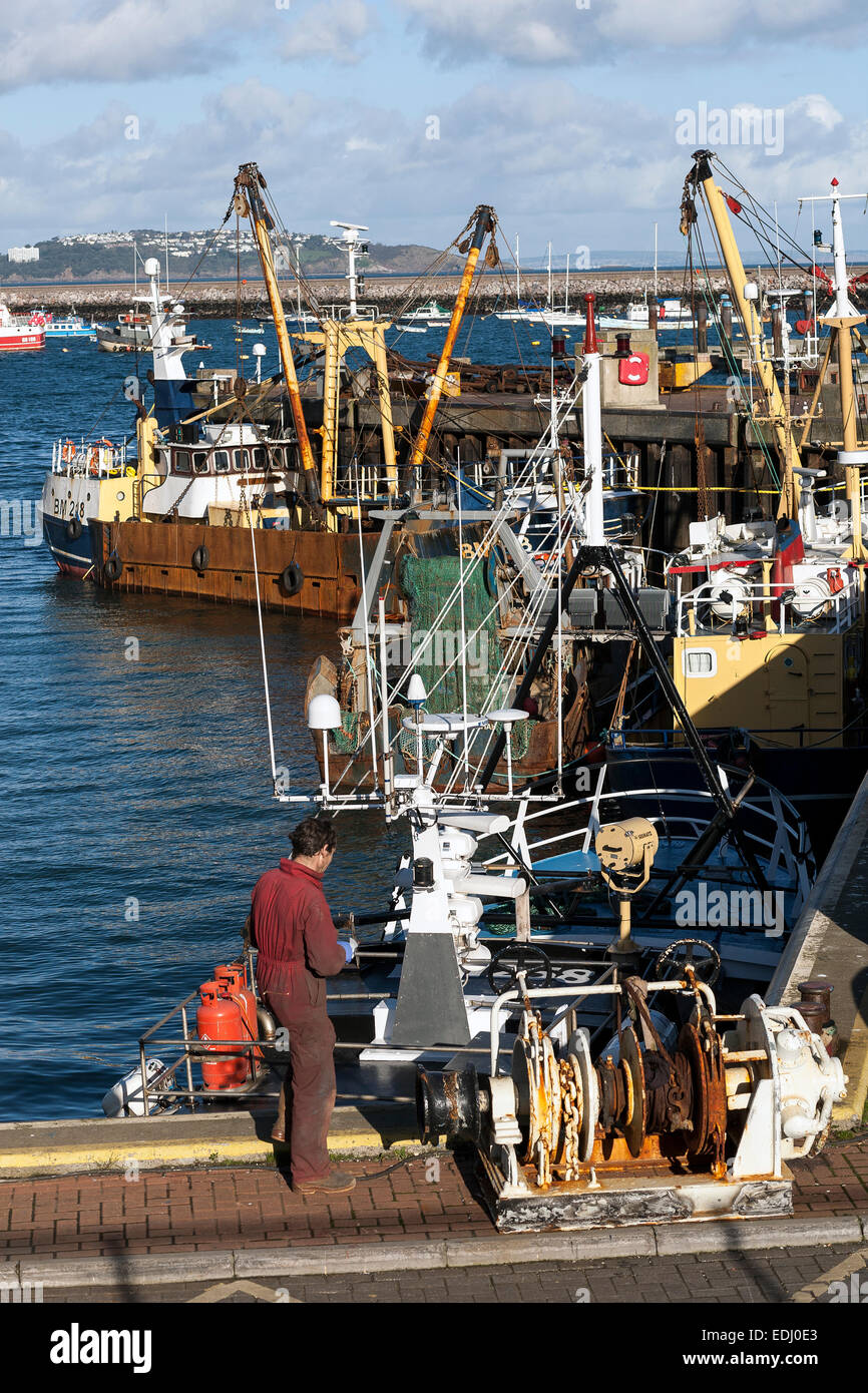 mechanic servicing brixham fishing fleet - Stock Image