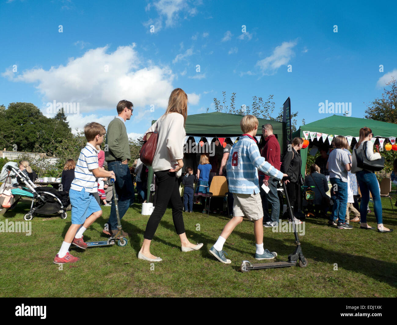 Family on a day out in autumn sunshine at Fulham Palace Apple Day in London, UK  KATHY DEWITT Stock Photo