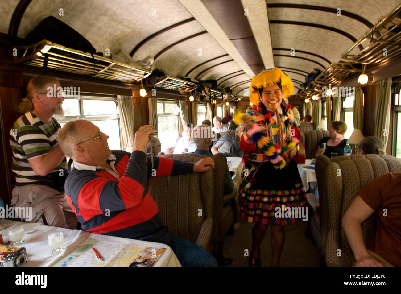 Andean Explorer, luxury train from Cusco to Puno. Train inside. Musicians and dancers in traditional costumes ride - Stock Image