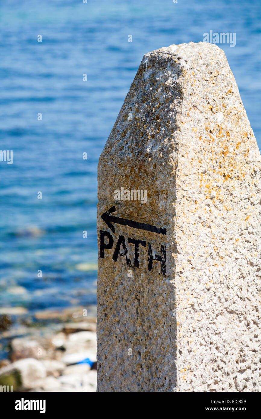 Stone with Path and arrow indicators at Swanage - Stock Image