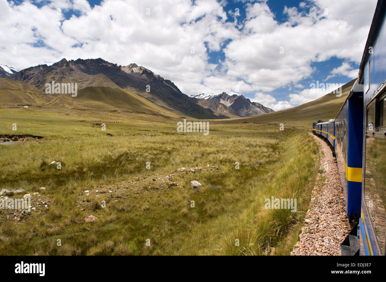 Andean Explorer, luxury train from Cusco to Puno. Peruvian altiplano landscape seen from inside the Andean Explorer - Stock Image