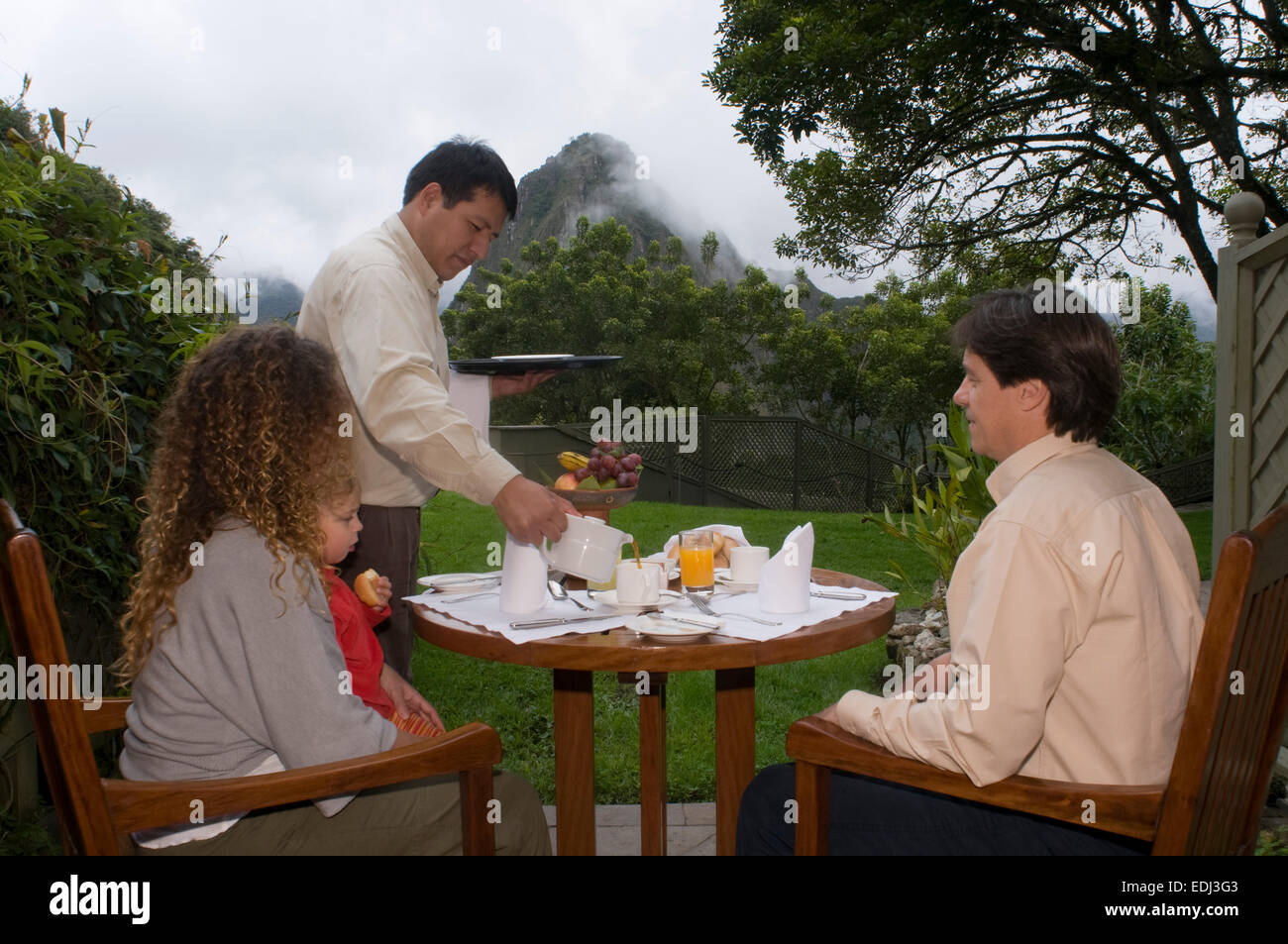 Belmond Sanctuary Lodge - Hotel in Machu Picchu, Peru. Breakfast in the garden in the back of one of the rooms at - Stock Image
