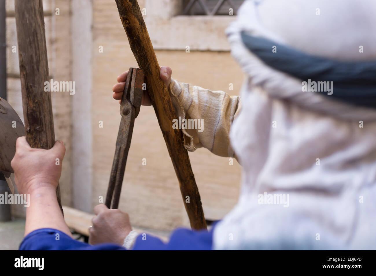 reenactment of an ancient roman blacksmith - Stock Image