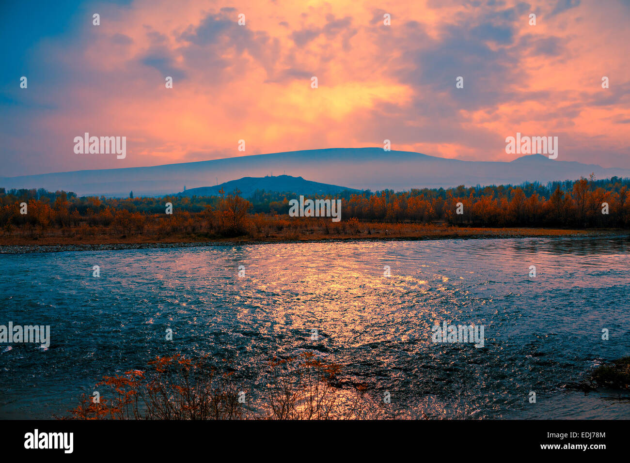 Foggy sunset over mountain river Stock Photo
