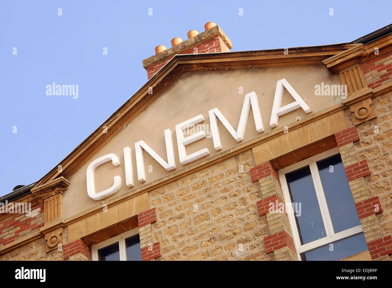 Cinema sign on the facade of an old building in Sedan, France