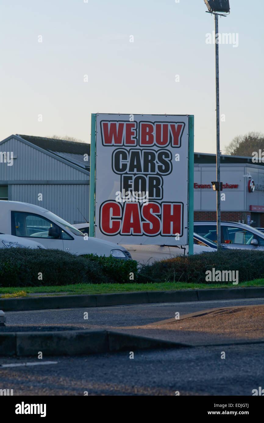 We buy cars for cash sign outside Evans Halshaw garage, Bedford ...