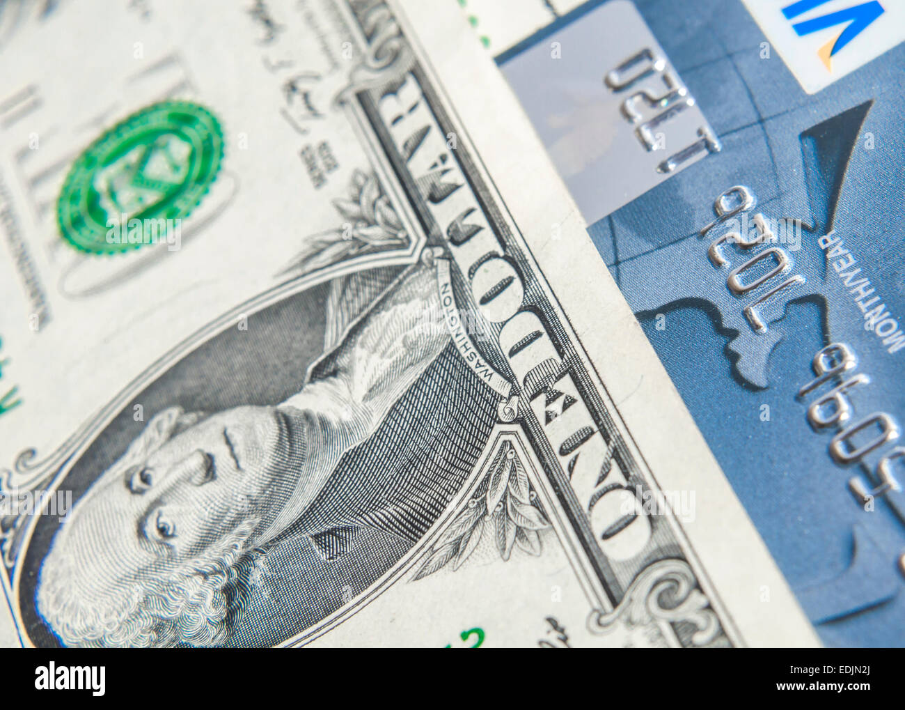 Credit Card on dollar bills as wealthy concept. Close up. - Stock Image