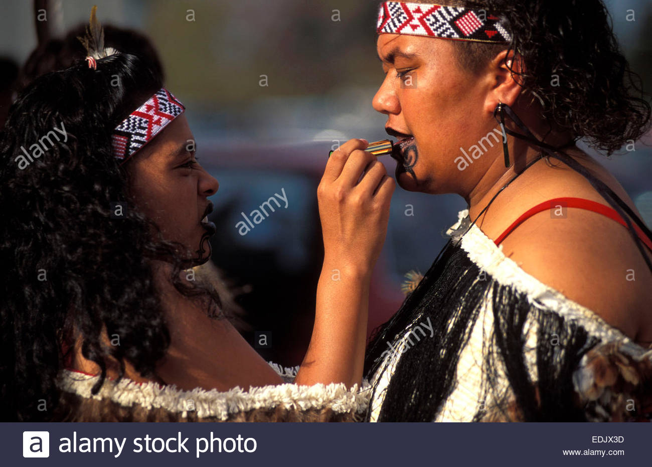 Maori woman making up, North Island, New Zealand - Stock Image