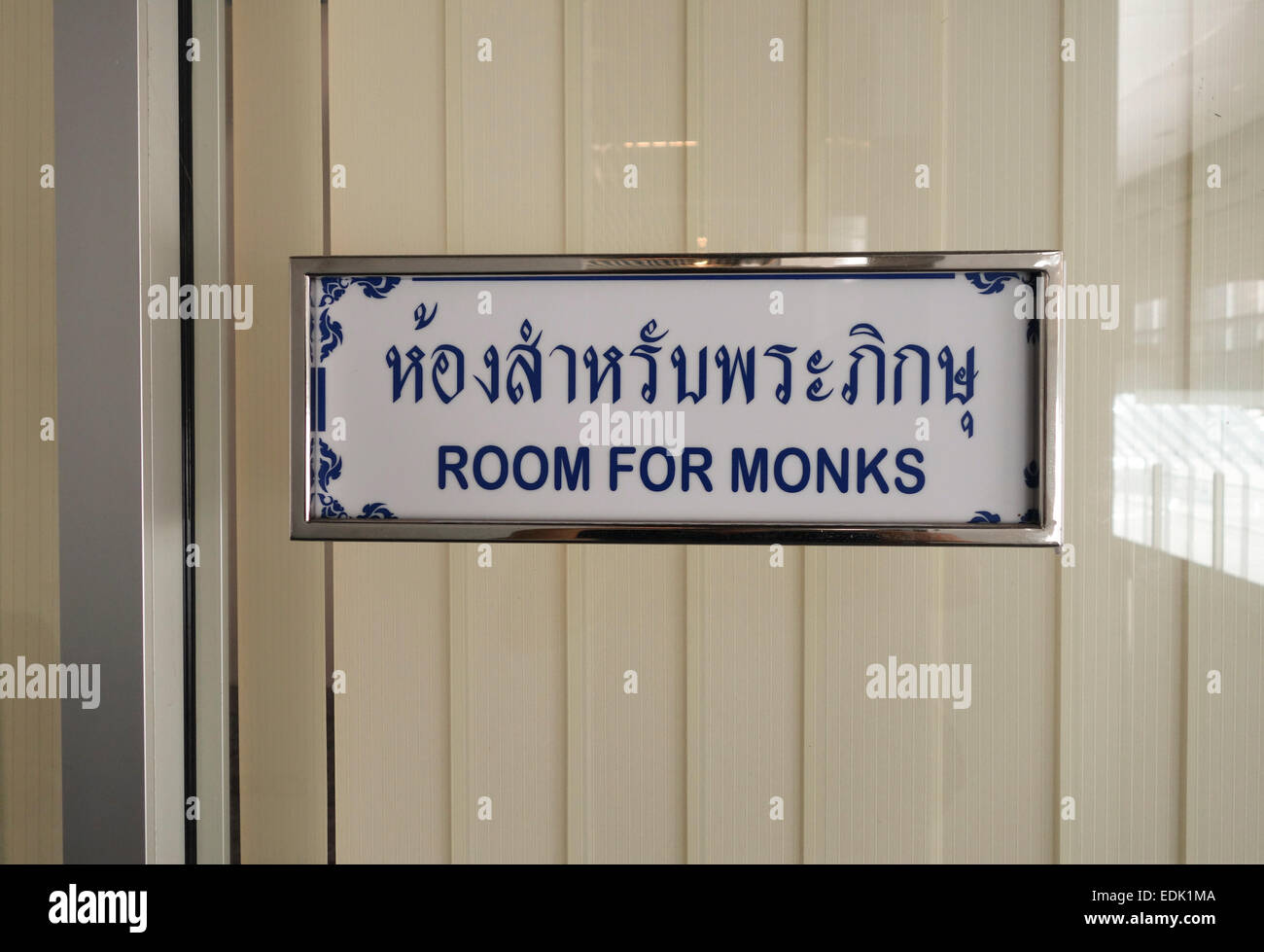 Sign waiting room for monks only at Suvarnabhumi airport Bangkok. Thailand. Southeast Asia. Stock Photo