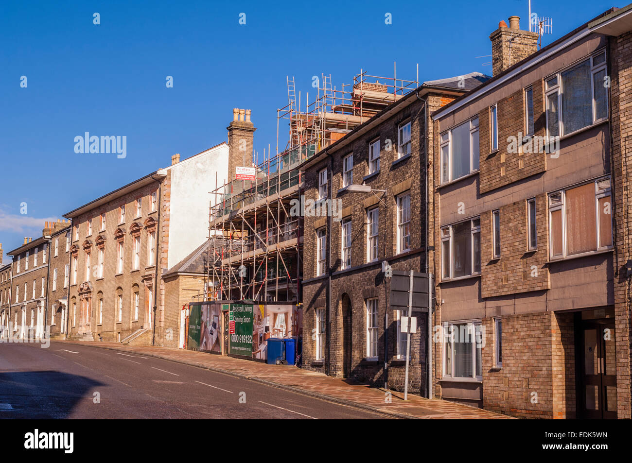 Scaffolding on a large house in a UK street - Stock Image