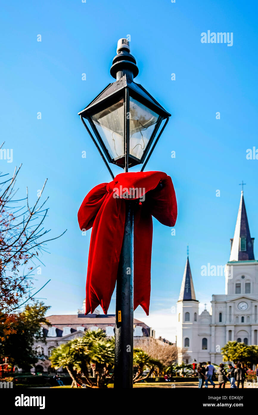 Red Bows tied to the lanterns around Jackson Square in New Orleans at Christmas - Stock Image