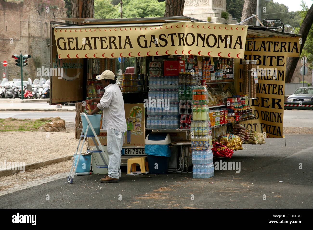 Man cleaning snack stand in a park in Rome,Italy - Stock Image